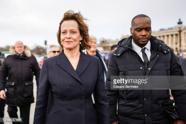 Sigourney Weaver wears a navy blue blazer jacket outside Dior during Paris Fashion Week Womenswear Fall/Winter 2020/2021 on February 25 2020 in Paris...