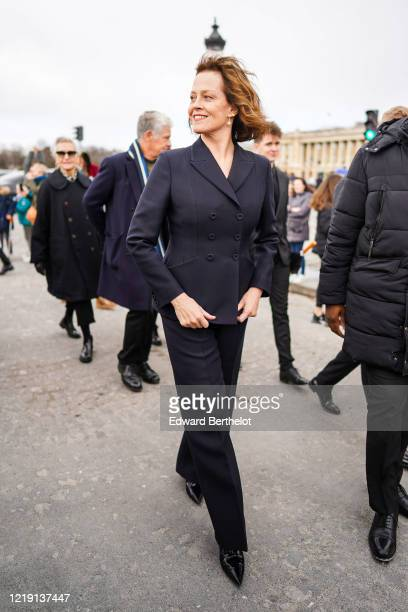 Sigourney Weaver wears a navy blue blazer jacket pants pointy shoes outside Dior during Paris Fashion Week Womenswear Fall/Winter 2020/2021 on...