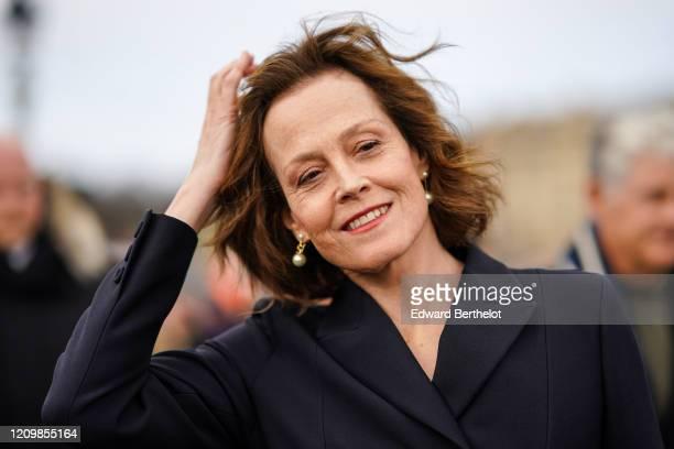 Sigourney Weaver wears earrings, a blazer jacket, outside Dior, during Paris Fashion Week - Womenswear Fall/Winter 2020/2021, on February 25, 2020 in...