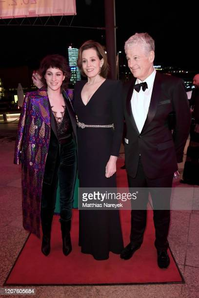 Sigourney Weaver with husband Jim Simpson and daughter Charlotte Simpson attend the opening party during the 70th Berlinale International Film...
