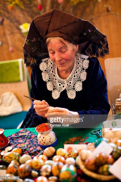 Sigrid Bolduan from the village Klein Loitz wearing a traditional Lusatian sorbian folk dress paints an Easter egg in traditional Sorbian motives at...