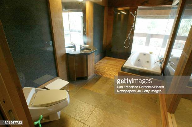 Sigstyle071_mac.jpg Inside the Master Bath, the shower is free standing and has no walls, the water drains between redwood slats in the floor....