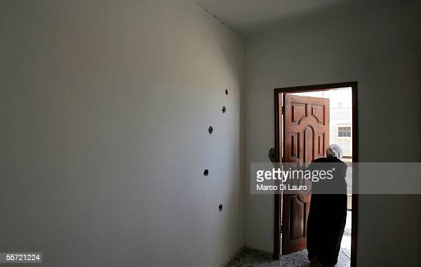 Siham Kishta 45yearsold stands in the front door area of her house while bullet holes mar the inside wall on September 19 2005 in Rafah refugee camp...