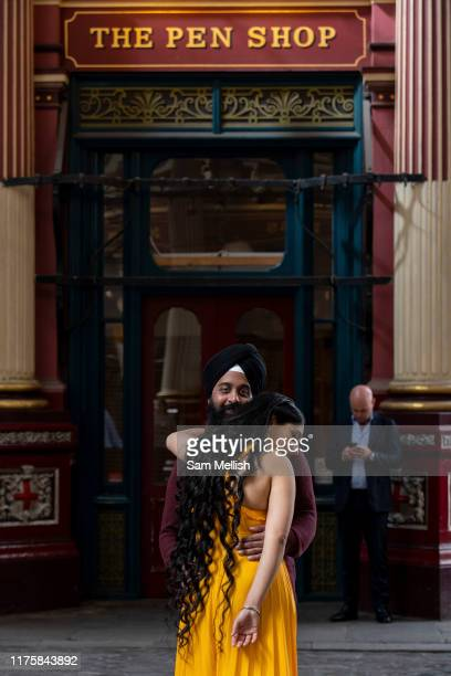 A Sihk couple hugging one another at Leadenhall Market on the 12th September in London in the United Kingdom