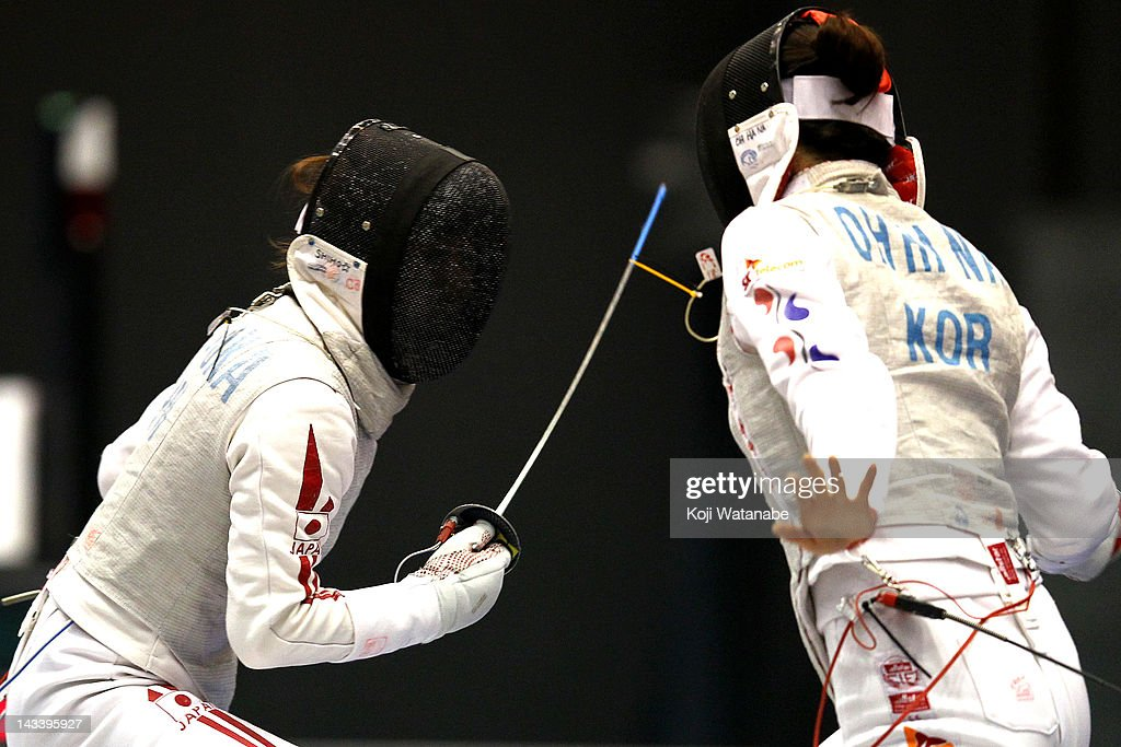 Siho Nishioka of Japan competes against Jung Gil Ok of South Korea in the Women's Foil Team Tableau of final on day four of the 2012 Asian Fencing Championships at Wakayama Big Wave on April 25, 2012 in Wakayama, Japan.