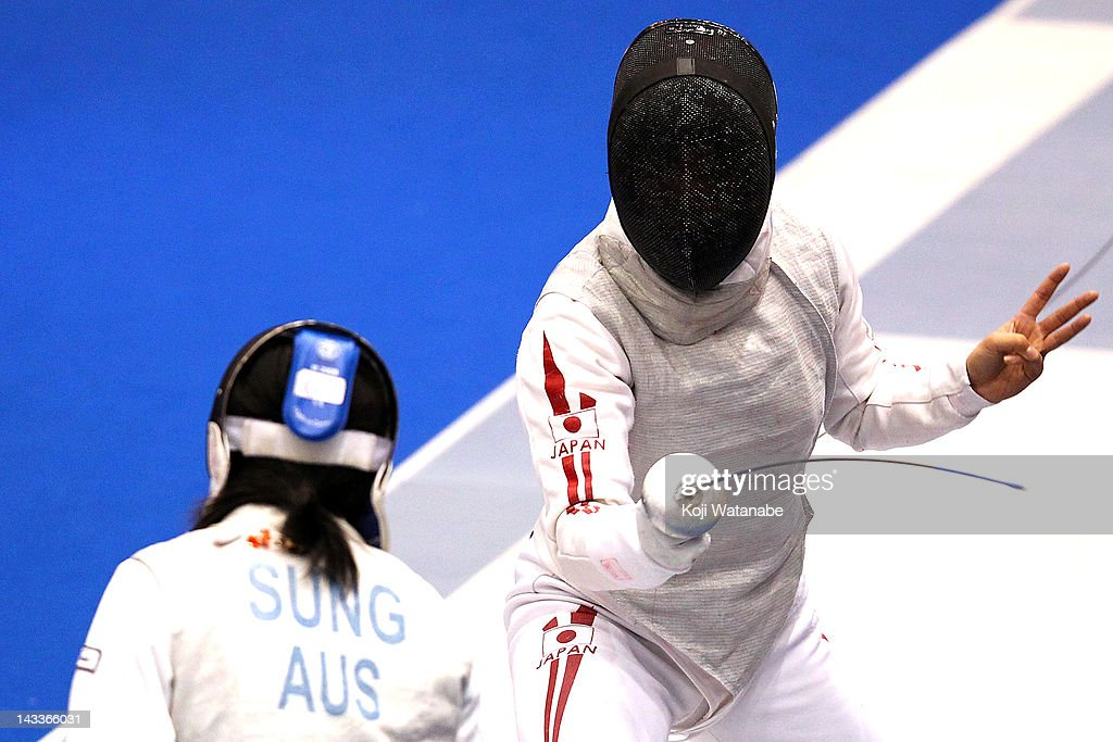 Siho Nishioka of Japan competes against Sung Lishan of Australia in the Women's Foil Team Tableau of 8 on day four of the 2012 Asian Fencing Championships at Wakayama Big Wave on April 25, 2012 in Wakayama, Japan.