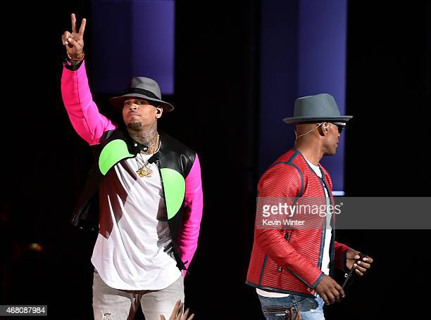Siinger Chris Brown and host Jamie Foxx perform onstage during the 2015 iHeartRadio Music Awards which broadcasted live on NBC from The Shrine...