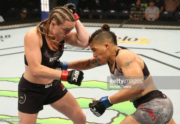 Sijara Eubanks punches Aspen Ladd in their women's bantamweight bout during the UFC Fight Night event at Blue Cross Arena on May 18 2019 in Rochester...