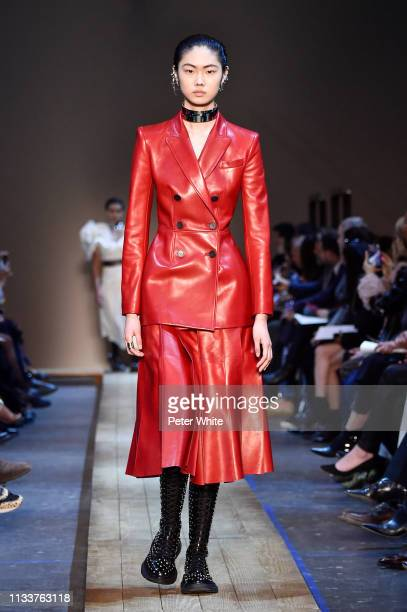 Sijia Kang walks the runway during the Alexander McQueen show as part of the Paris Fashion Week Womenswear Fall/Winter 2019/2020 on March 04, 2019 in...