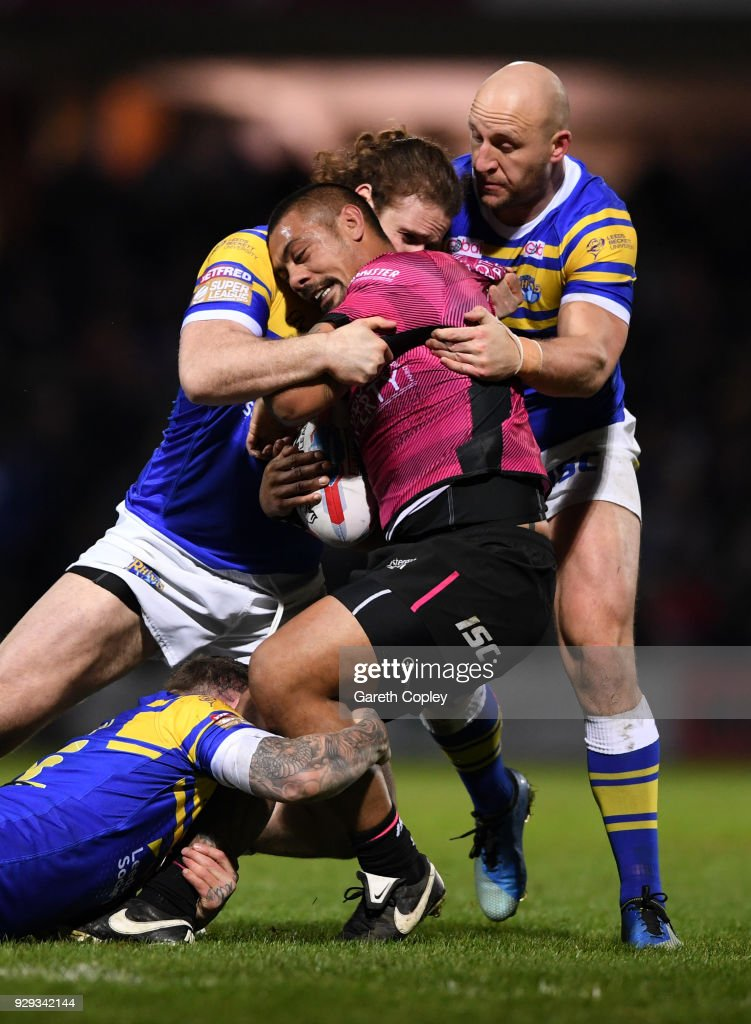 Sika Manu of Hull FC is tackled by Anthony Mullally, Brett Delaney and Karl Ablett of Leeds during the Betfred Super League match between Leeds Rhinos and Hull FC at Headingley Stadium on March 8, 2018 in Leeds, England.