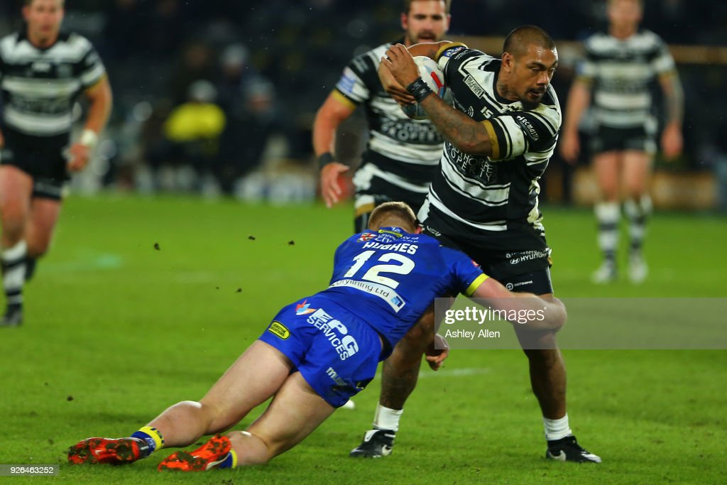 Sika Manu of Hull FC is tackled by Jack Hughes of Warrington Wolves during the BetFred Super League match between Hull FC and Warrington Wolves at KCOM Stadium on March 2, 2018 in Hull, England.