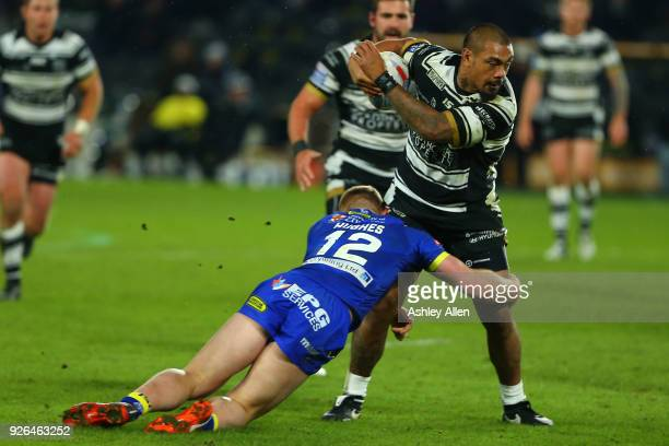 Sika Manu of Hull FC is tackled by Jack Hughes of Warrington Wolves during the BetFred Super League match between Hull FC and Warrington Wolves at...