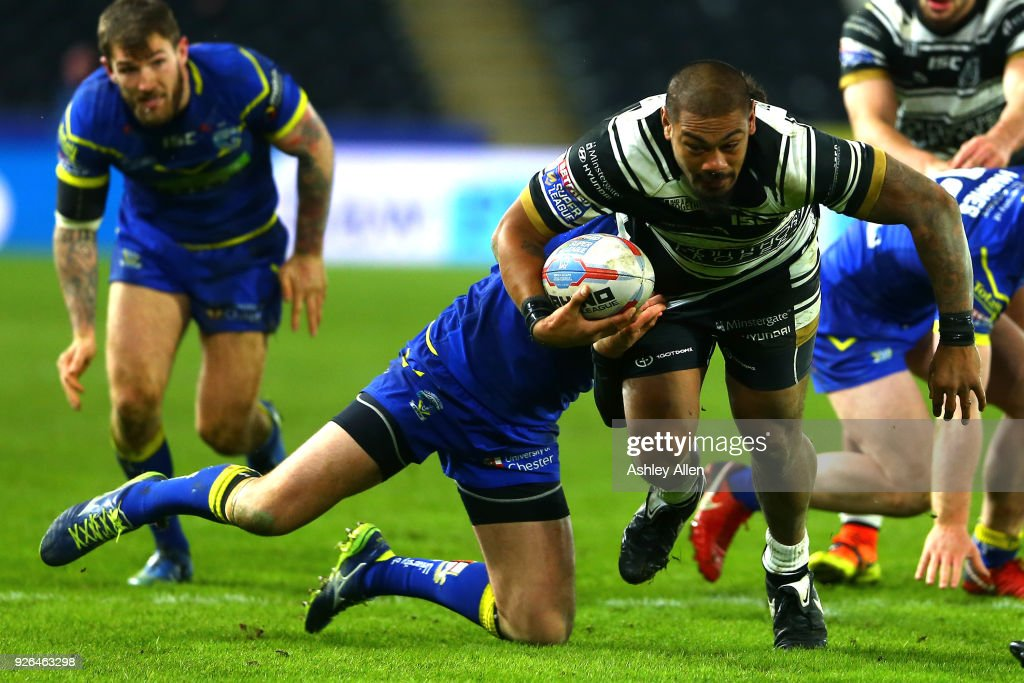 Sika Manu of Hull FC tackled by Matty Russell of Warrington Wolves during the BetFred Super League match between Hull FC and Warrington Wolves at KCOM Stadium on March 2, 2018 in Hull, England.