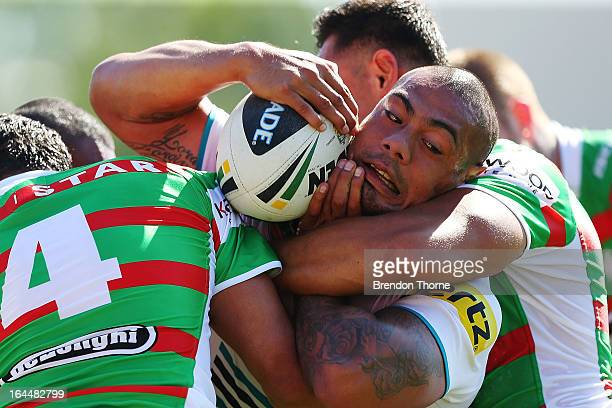 Sika Manu of the Panthers is tackled by the Rabbitohs defence during the round three NRL match between the Penrith Panthers and the South Sydney...
