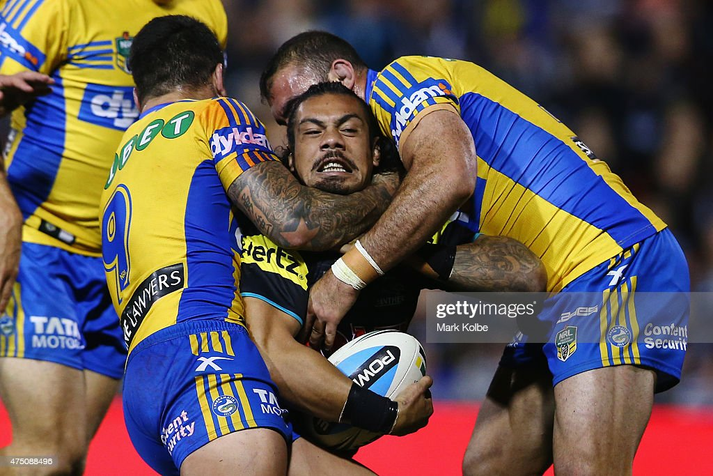 Sika Manu of the Panthers is tackled during the round 12 NRL match between Penrith Panthers and the Parramatta Eels at Pepper Stadium on May 29, 2015 in Sydney, Australia.