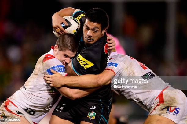 Sika Manu of the Panthers is tackled during the round 14 NRL match between the Penrith Panthers and the St George Illawarra Dragons at Sportingbet...