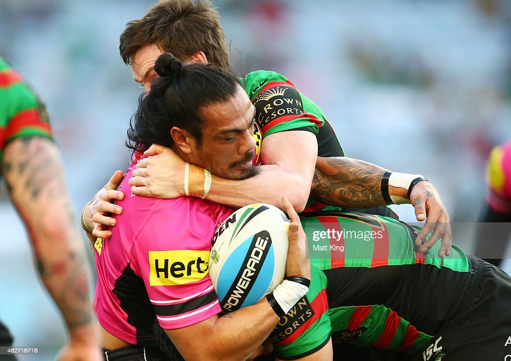 Sika Manu of the Panthers is tackled uring the round 21 NRL match between the South Sydney Rabbitohs and the Penrith Panthers at ANZ Stadium on August 2, 2015 in Sydney, Australia.