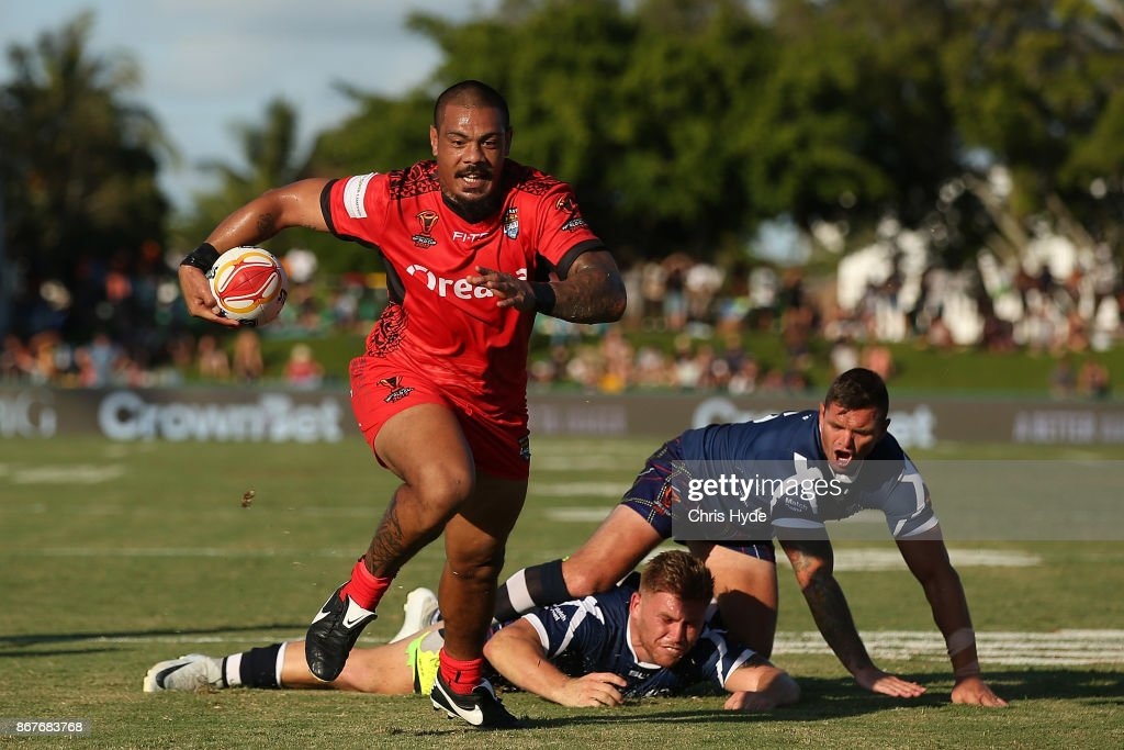 Sika Manu of Tonga makes a break to score a try during the 2017 Rugby League World Cup match between Scotland and Tonga at Barlow Park on October 29, 2017 in Cairns, Australia.