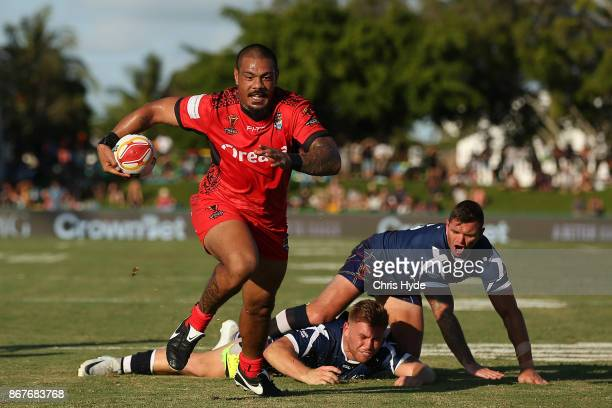Sika Manu of Tonga makes a break to score a try during the 2017 Rugby League World Cup match between Scotland and Tonga at Barlow Park on October 29...