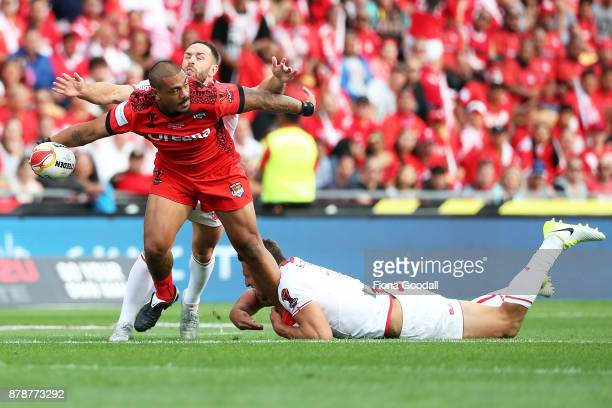 Sika Manu of Tonga passes the ball during the 2017 Rugby League World Cup Semi Final match between Tonga and England at Mt Smart Stadium on November...