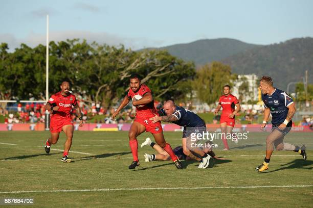 Sika Peni Terepo makes a break to score a try during the 2017 Rugby League World Cup match between Scotland and Tonga at Barlow Park on October 29...