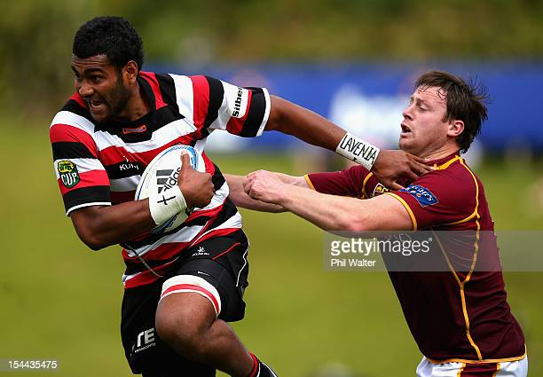 Sikeli Nabou of Counties fends off Dion Bates of Southland during the ITM Cup Championship Semifinal match between Counties Manukau and Southland at...