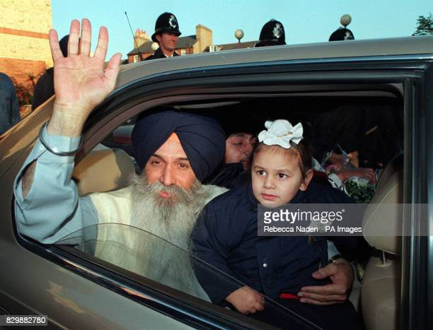 Sikh activist Karamjit Singh Chahal waves as he leaves Bedford Prison with his nephew Harpal Singh Gill after being freed this afternoon following a...