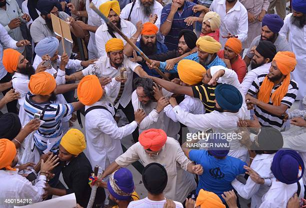 Sikh activists clash with members of the Shiromani Gurudwara Prabhandak Committee during commemorations for the 30th anniversary of Operation Blue...