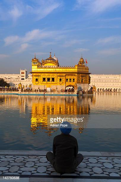 sikh at prayer, golden temple, amritsar - golden temple india stock photos and pictures