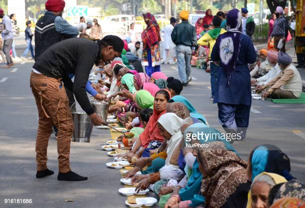 Sikh community members serve 'langar' or lunch along Akbar road to demonstrators who gathered to demand arrest of Congress leader Jagdish Tytler for...