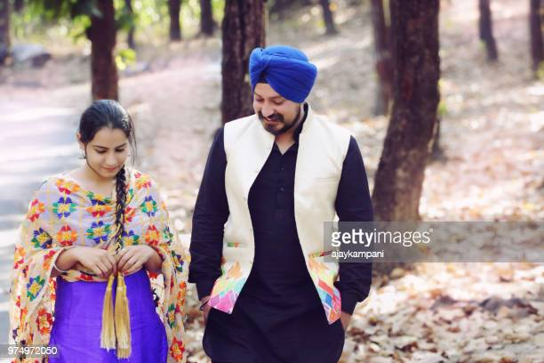 sikh couple discussion at park - sikh stock pictures, royalty-free photos & images