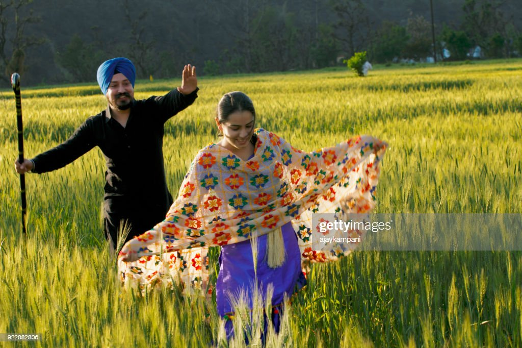 Sikh couple in a Wheat field