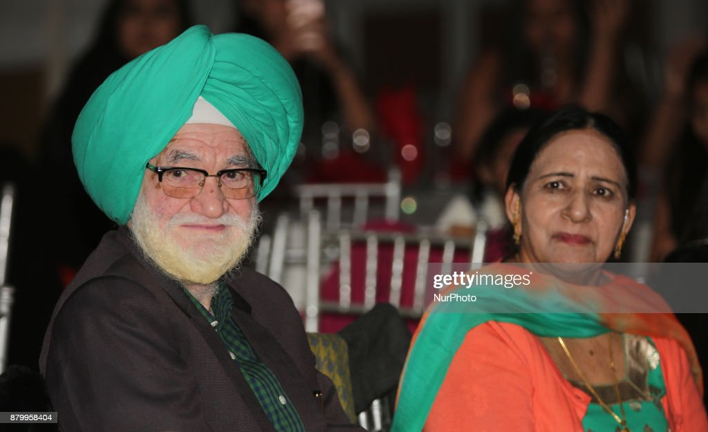 Sikh couple watches a dance performance during the Diwali Gala Celebration held in Mississauga Ontario Canada on 25 November 2017 This luxurious gala.
