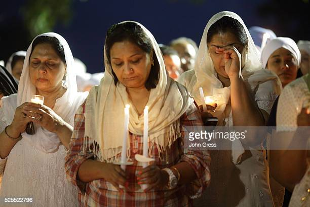 A Sikh cries during a vigil in Oak Creek Wisconsin on August 7 2012 A gunman killed six people and critically wounded three at a Sikh temple in an...