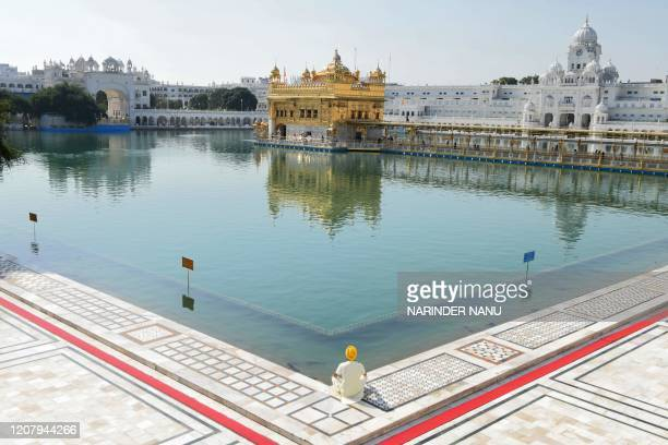 Sikh devotee pays his respects at the Golden Temple during a oneday Janata curfew imposed by the Indian government as a preventive measure against...