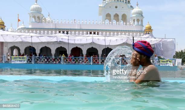 Sikh Devotee take a holy dip in the sarovar on the occasion of Baisakhi at Takht Sri Damdama Sahib on April 13 2018 in Bathinda India Baisakhi...