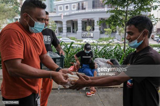 Sikh devotee volunteers wearing face masks distribute food to homeless people. Malaysia has reported 2,018 new cases of Coronavirus today bringing...
