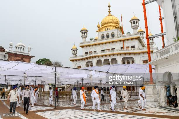 Sikh devotees arrive to pay respect on the occasion of the 36th anniversary of Operation Blue Star near the Sri Akal Takhat Sahib complex building of...