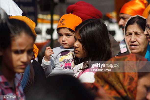 Sikh Devotees offer prayers at Gurdwara on the occasion of 543rd anniversary of the founder of Sikh religion Guru Nanak at Sector 18 on November 28,...