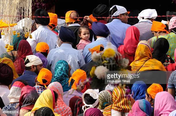 Sikh devotees offer prayers on the birth anniversary of Guru Nanak Dev at Gurudwara, on November 25, 2015 in Noida, India. Guru Nanak's Prakash Utsav...