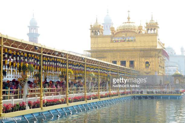Sikh devotees pay respect on the occasion of the birth anniversary of the fourth Sikh Guru Ram Das at the Golden Temple in Amritsar on October 15 2019