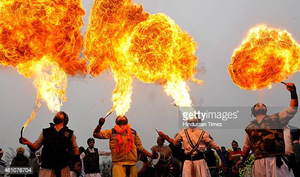 Sikh devotees performing fire breath during Nagar Kirtan procession carried out on the occasion of 349th birth anniversary celebrations of Guru...