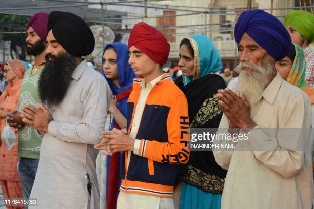 Sikh devotees pray at the Golden Temple to mark Bandi Chhor Divas which coincides with the day of Diwali in Amritsar on October 27 2019 Sikhs...