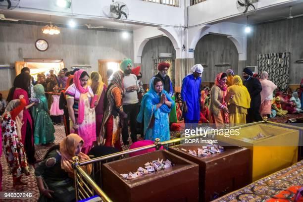 Sikh devotees pray inside the gurdwara or a Sikh temple during the Baisakhi festival in Srinagar Indian administered Kashmir Baisakhi marks the Sikh...