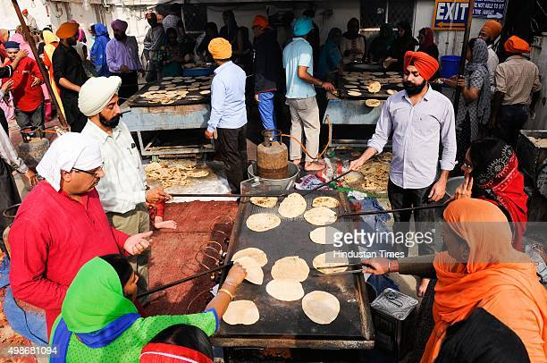 Sikh devotees prepare langar on the birth anniversary of Guru Nanak Dev at Gurudwara, on November 25, 2015 in Noida, India. Guru Nanak's Prakash...