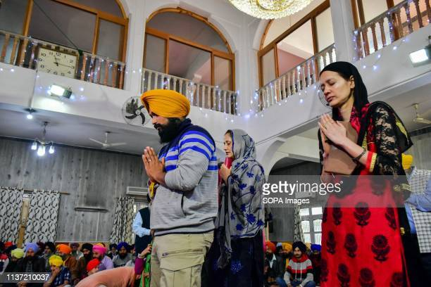 Sikh devotees seen praying inside the gurdwara or a Sikh temple during the festival Baisakhi marks the Sikh New Year and is also celebrated as...