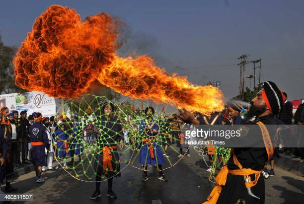 Sikh devotees show their skill in martial arts during 'Nagar Kirtan' carried out as part of 'Prakash Utsav' which is the birth anniversary...