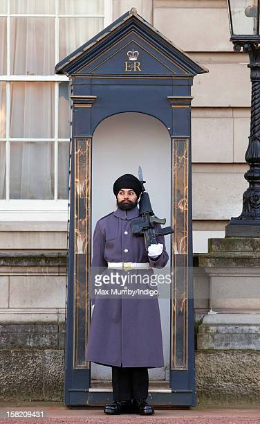 Sikh Guardsman Jatenderpal Singh Bhullar a soldier in the Scots Guards stands by his sentry box whilst on guard duty in the forecourt of Buckingham...