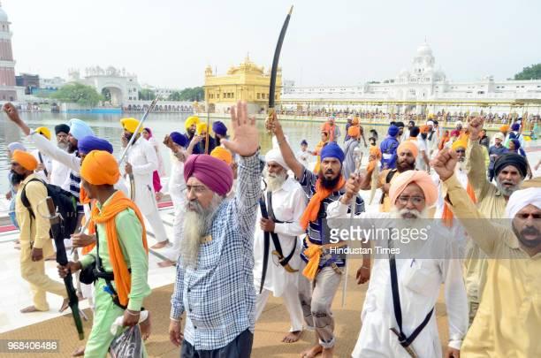 Sikh hardliners brandishing swords and raising pro-khalistan slogans on the anniversary of Operation Bluestar at Golden Temple complex on June 6 2018...
