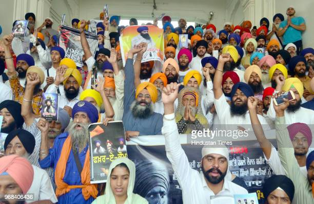 Sikh hardliners raising pro-khalistan slogans and displaying posters of Jarnail Singh Bhindranwale and other militants in front of Akal Takht during...